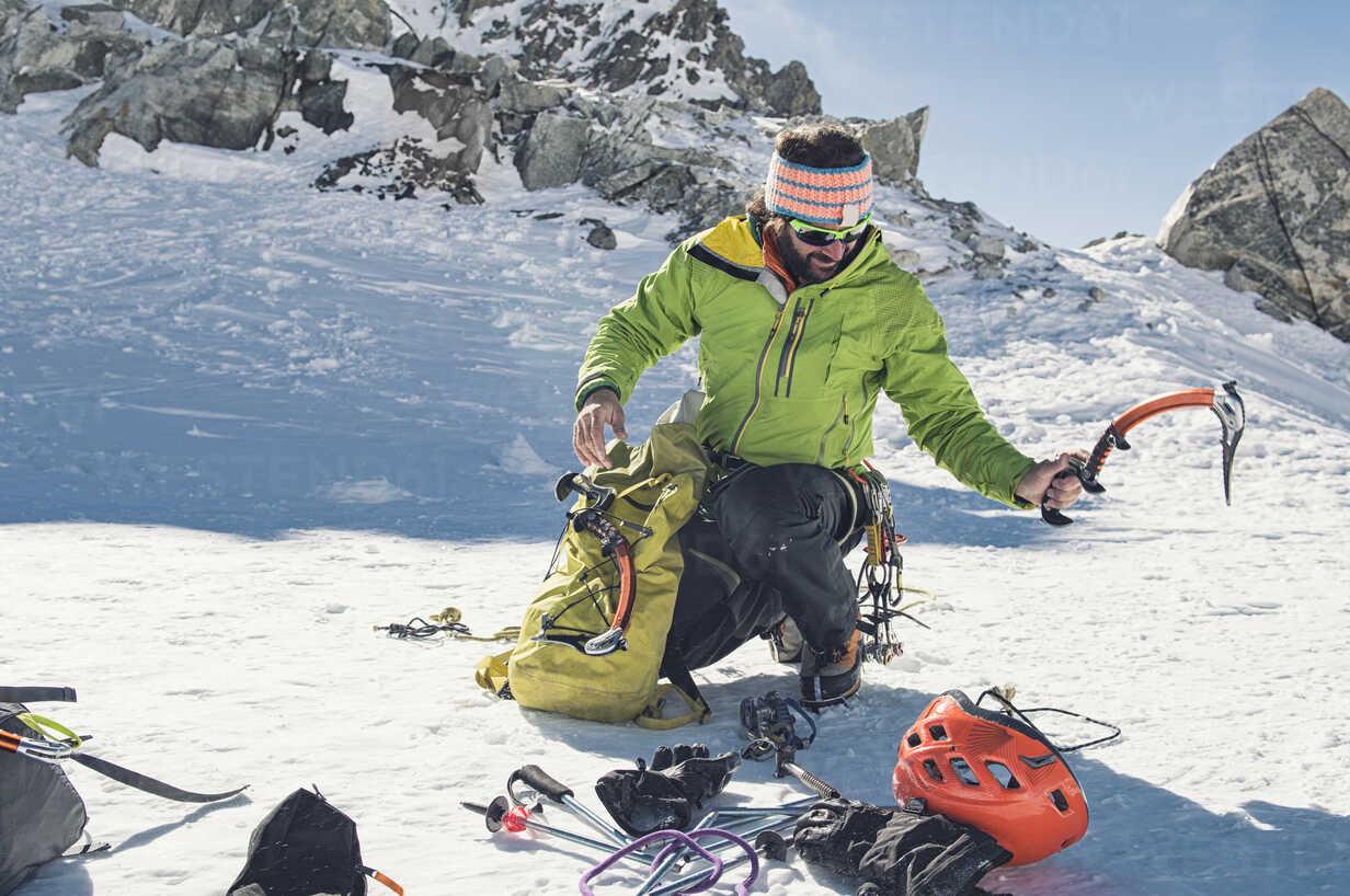 climbing equipment crouching on mountain